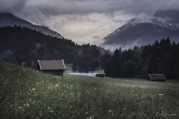 Another view of the Geroldsee Valley with alpine cabins scattered around the meadow (long lens)